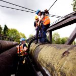PMP Utilities, specialists in confined space and rope access regulations, Working on a pipe bridge