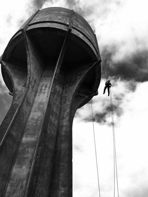 PMP rope access working on a water tower