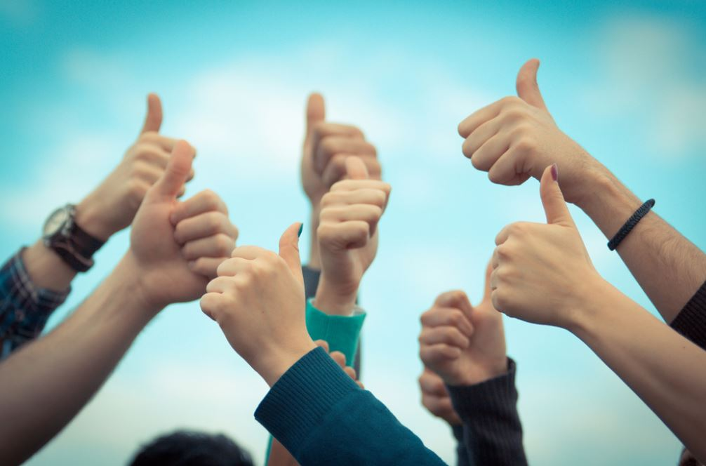 Thumbs up from people