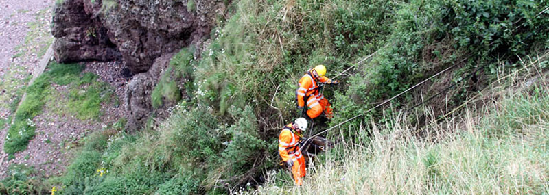 PMP Utilities climbing outdoors to inspect and remove debris from sea outfall