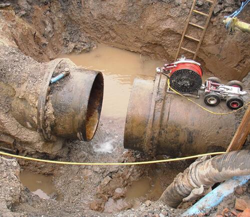 PMP Utilities pipeline repair in the mud